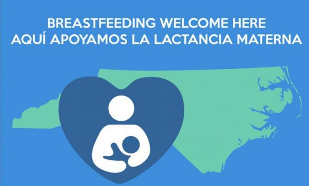 Breastfeeding parent child in blue heart with shape of North Carolina in green in the background